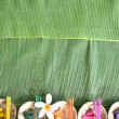 Colorful incenses on banana leaf — Stock Photo