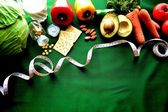 Vegetable,diet food with tape measure — Foto Stock