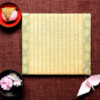 Japanese cake ,cherry blossom and tatami — Stock Photo