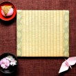 Japanese cake ,cherry blossom and tatami — Stock Photo #10269221