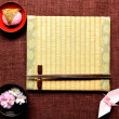 Japanese cake,cherry blossom and tatami — Stock Photo #10269278