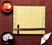 Japanese cake,cherry blossom and tatami — Stock Photo