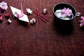 Cherry blossom and origami crane — Stock Photo