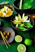 Asian tropical flowers with incense — Stock Photo