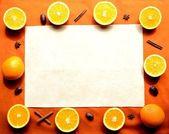 Orange with spice on orange color background,frame — Stock Photo