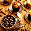 A cup of coffee beans and muffins — Stock Photo