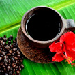 Coffee cup with red hibiscus — Stock Photo #9669144