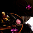 Purple orchid and Asian spa supplies — Stock Photo