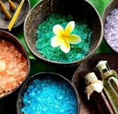 Colorful bath salt with plumeria — Stock Photo