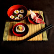 Sushi,mum,origami and tatami mat — Stock Photo #9722807