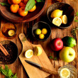 Fruits with cutting board — Stock Photo