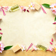 Pink plumeria and spa supplies — Stock Photo