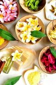 Asian tropical flowers and spa supplies — Stock Photo