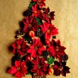 Christmas tree of red poinsettia — Stock Photo #9931212