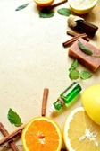 Citrus fruits and aromatherapy supplies — Stock Photo