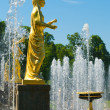 Old statue on fountains background. Russia, St.Petersburg, Petrodvorets. — Stock Photo