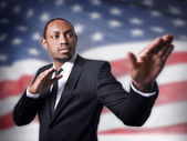 Young African American guy and a flag — Stock Photo