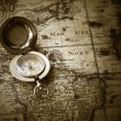 Old compass on vintage map — Stock Photo