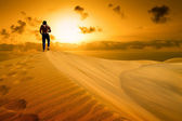 The man be ready to drop with weariness in desert. — Stock Photo