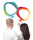 Isolated couple discussing with speech bubbles — Stock Photo