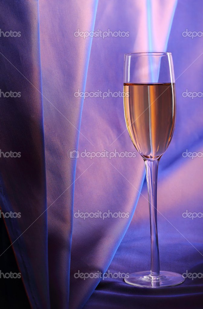 Celebratory glass of champagne on a dark blue background — Stock Photo #8245350
