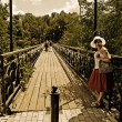 Stock Photo: Bridge and girl at rail