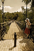The bridge and the girl at the rail — Stock Photo
