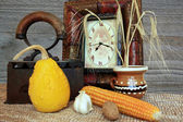 Vintage clock with old iron and clay mug in autumnal arrangement — Stock Photo