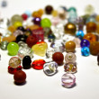 Foto Stock: Colored jewel stones over white background