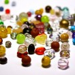 Foto Stock: Multicolored jewel stones over white background