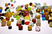 Multicolored jewel stones over white background — Stock Photo