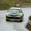Stock Photo: Green car durring competition at Brasov rally