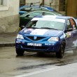 Blue Dacia Logan durring the competition at Brasov rally — Stock Photo