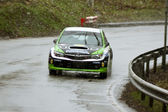Green car durring the competition at Brasov rally — Stok fotoğraf