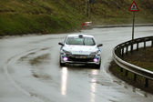 White car durring the competition at Brasov rally — Zdjęcie stockowe