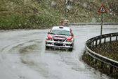 One of the rally competitors in curve at Brasov rally — Stock Photo