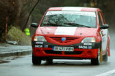 Red Dacia Logan Rally car in competition — Stock Photo