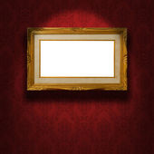 Empty golden frame on the wall. — Stock Photo
