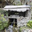 Historic water mill in Himalaya - Stock Photo