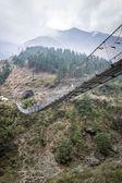 Hängande footbridge i nepal — Stockfoto