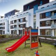 Children playground on real estate - Foto Stock