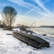 Boat on the beach in winter time — Stock Photo