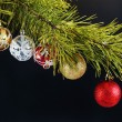 Coniferous branch decorated with New Year balls — Stock Photo