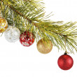Stock Photo: Coniferous branch decorated with New Year balls