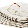 Royalty-Free Stock Photo: Big pile of newspapers and glasses