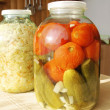 Glass jar with tinned vegetables on a table — Stock Photo