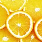 Oranges cut on segments — Stock Photo