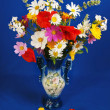 The luxuriant bouquet of various flowers on a dark blue background - Stockfoto