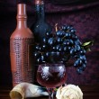 Classical still life with grapes and a wine bottles — Stock Photo