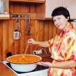Стоковое фото: Womcooks jam of sea-buckthorn